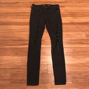 Ripped black express skinny jeans